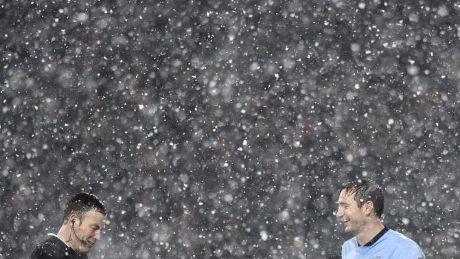 Referee Clattenburg and Manchester City's Lampard share a light moment in the snow during the English Premier League soccer match between Manchester City and West Bromwich Albion at The Hawthorns in West Bromwich, central England