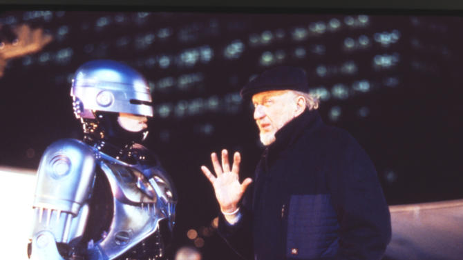 """FILE - This 1990 file photo released by Orion Pictures Corp. shows film director Irvin Kershner, right, and actor Peter Weller, portraying Robocop, during the making of """"Robocop II."""" Plans are moving forward for a Detroit statue of the fictional crime-fighting cyborg RoboCop. The Detroit News reports Wednesday, April 4, 2012 that a RoboCop model is being scanned at a studio in Canada. When the scanning process is completed, artists will create foam pieces that will be shipped to Detroit's Venus Bronze Works, where the parts of the statue will be cast.    (AP Photo/Orion Pictures Corp., Deana Newcomb, File)"""