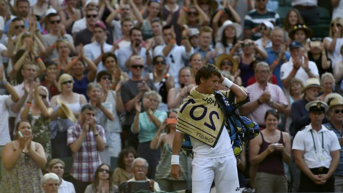 Ricardas Berankis of Lithuania is applauded by fans after losing his match against Marin Cilic of Croatia at the Wimbledon Tennis Championships in London