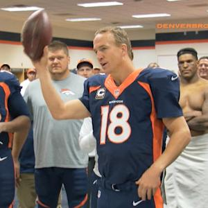 Denver Broncos quarterback Peyton Manning gets the game ball after record-setting day