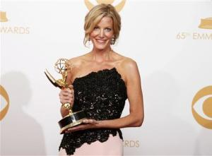 Gunn poses with her award for Outstanding Supporting Actress In A Drama Series at the 65th Primetime Emmy Awards in Los Angeles