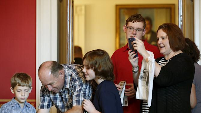 Visitors take photos during a tour of the White House in Washington