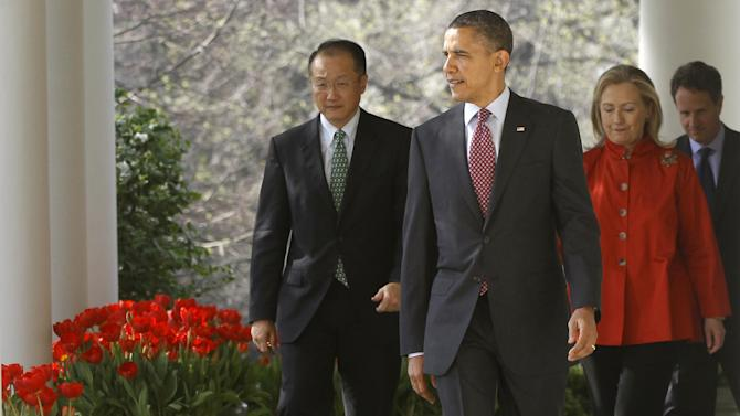 President Barack Obama walks with Jim Yong Kim, his nominee to be the next World Bank President, Secretary of State Hillary Rodham Clinton, and Treasury Secretary Timothy Geithner to the Rose Garden of the White House in Washington, Friday, March 23, 2012. Kim is currently the president of Dartmouth College. (AP Photo/Charles Dharapak)