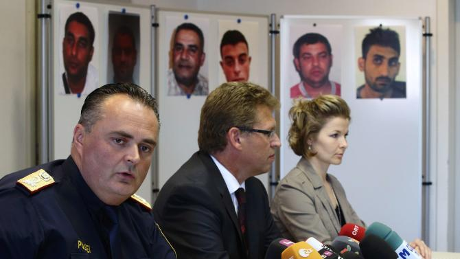 Head of Burgenland province police Doskozil and prosecutors Fuchs and Strnad address a news conference in Eisenstadt