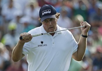 Phil Mickelson is three shots off the lead. (AP Photo)