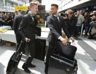 Borussia Dortmund Marco Reus (L) and Moritz Leitner arrive at Dortmund's airport May 24, 2013, to depart for London. German Bundesliga soccer clubs Borussia Dortmund and Bayern Munich will play in the Champions League final at Wembley in London on Saturday. REUTERS/Wolfgang Rattay (GERMANY - Tags: SPORT SOCCER)