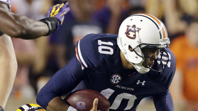 Auburn quarterback Kiehl Frazier (10) is sacked by LSU safety Micah Eugene (34) in the second half of an NCAA college football game Saturday, Sept. 22, 2012 at Jordan-Hare Stadium in Auburn, Ala. LSU beat Auburn 12-10. (AP Photo/Dave Martin)