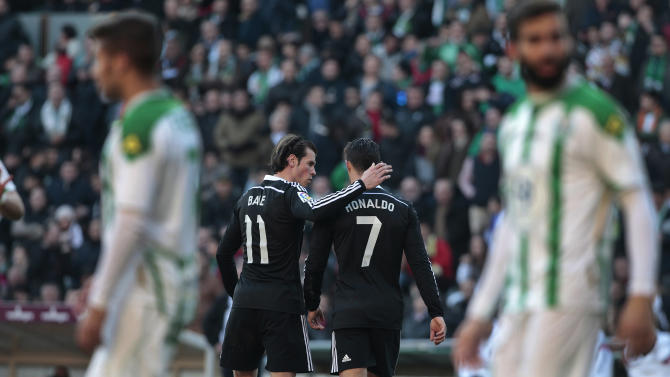 Real Madrid's Cristiano Ronaldo, right, walks after receiving red card as Gareth Bale, left, talks to him  during their game against Cordoba during their La Liga soccer match at the Arcangel stadium, in Cordoba, Spain on Saturday, Jan. 24, 2015. (AP Photo/Miguel Morenatti)