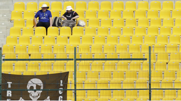 England fans soak up the sun during the second day of the second cricket test match of a three match series between England and Pakistan at the Zayed Cricket Stadium in Abu Dhabi, United Arab Emirates