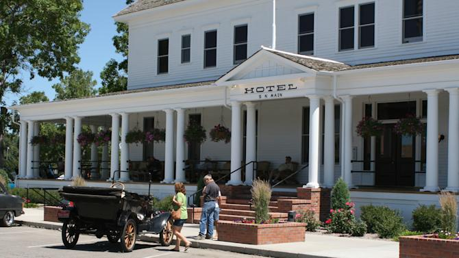 This July 23, 2011 photo released by Ron Zellar shows the recently rehabilitated Sacajawea Hotel in Three Forks, Mont. The hotel and town make an appealing stop on a road trip between Yellowstone and Glacier national parks. (AP Photo/Ron Zellar)