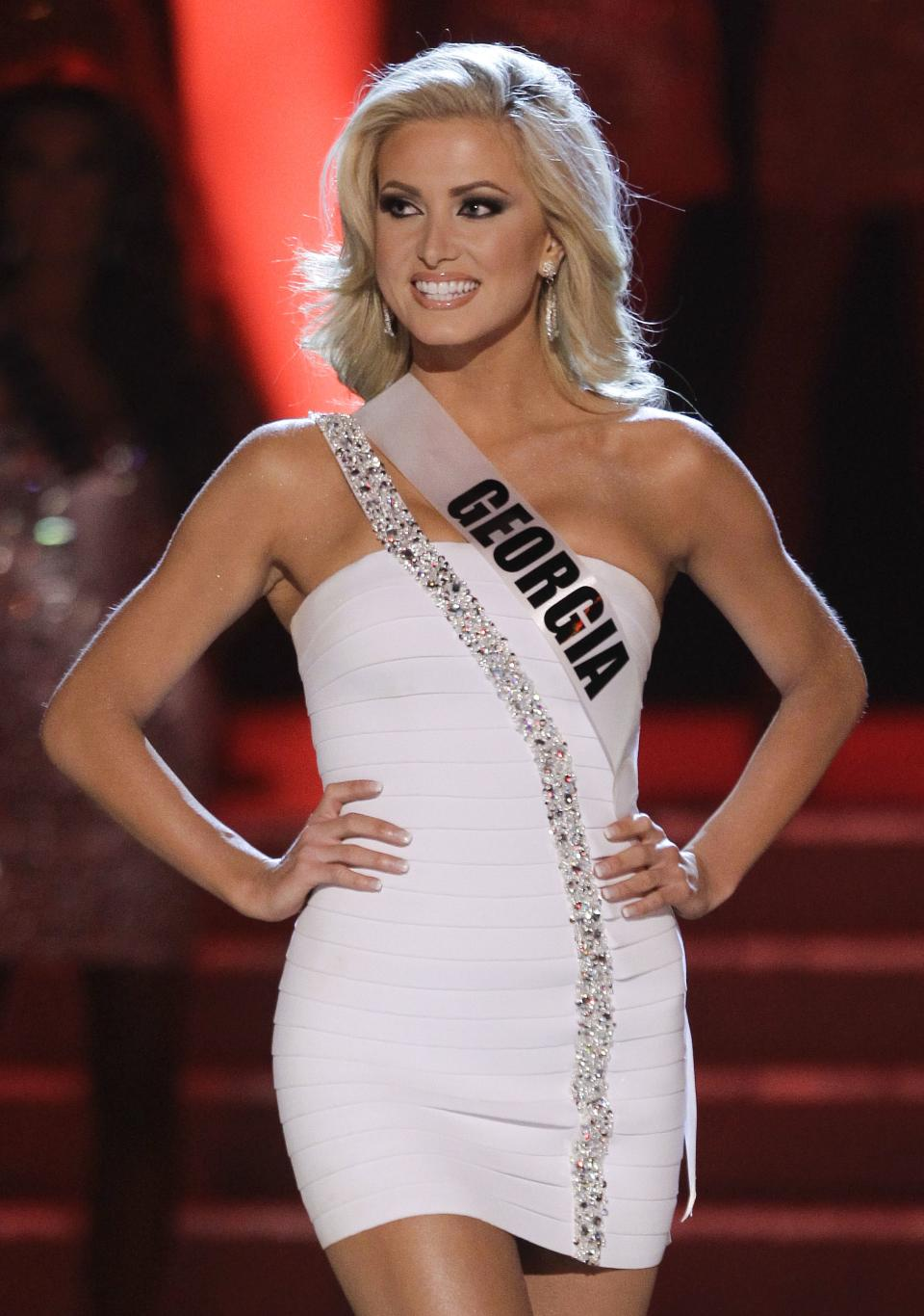 Kaylin Reque, Miss Georgia, is introduced as one of the 16 quarterfinalists during the Miss USA pageant, Sunday, June 19, 2011, in Las Vegas.  (AP Photo/Julie Jacobson)