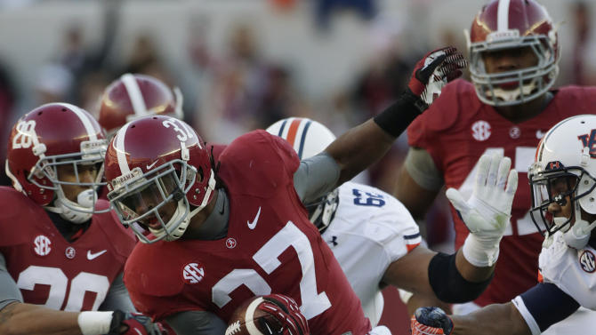 Alabama defensive back Robert Lester (37) returns an interception during the first half of a NCAA college football game as Auburn offensive lineman Chad Slade (62) pursues at Bryant-Denny Stadium in Tuscaloosa, Ala., Saturday, Nov. 24, 2012. (AP Photo/Dave Martin)