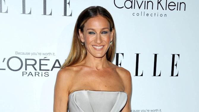 FILE - This Oct. 15, 2012 file photo shows Sarah Jessica Parker at the ELLE Women In Hollywood Celebration in Los Angeles. Parker and actor Gerard Butler will host the 19th annual Nobel Peace Prize Concert on Dec. 11 in Oslo, Norway. Jennifer Hudson and Seal are among the performers. (Photo by John Shearer/Invision/AP, file)
