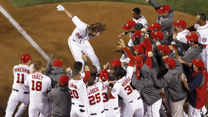 Washington Nationals' Jayson Werth leaps onto home plate after hitting a walk-off home run in the ninth inning against the St. Louis Cardinals in Game 4 of the National League baseball division series, Thursday, Oct. 11, 2012, in Washington. The Nationals won 2-1, sending the series to a deciding fifth game. (AP Photo/St. Louis Post-Dispatch, Chris Lee) EDWARDSVILLE OUT  ALTON OUT