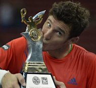 Juan Monaco of Argentina kissess his trophy after winning the men's singles final against Julien Benneteau of France at the ATP Malaysia Open tennis tournament in Kuala Lumpur on September 30. Monaco won 7-5, 4-6, 6-3