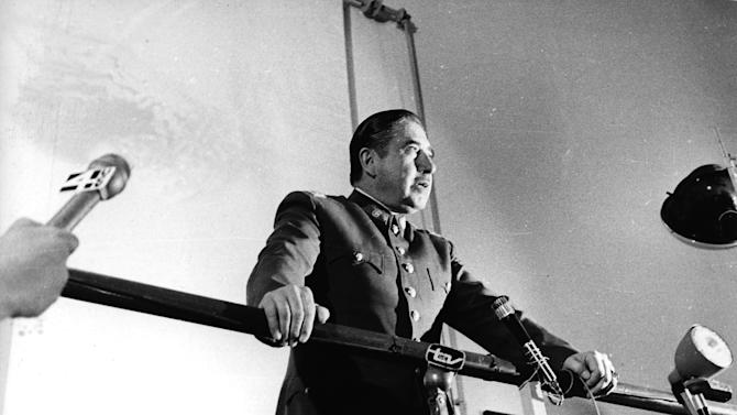 "FILE - In this 1974 file photo, Chilean dictator Gen. Augusto Pinochet speaks at an informal press conference in Santiago, Chile. Newly declassified U.S. documents indicate that Pinochet planned to use violence to annul the referendum that ended his brutal regime in 1988. The formerly secret documents posted by the independent U.S. National Security Archive on Friday, Feb. 22, 2013 showed U.S. officials warning Chilean leaders against violence if Pinochet tried to use force to stay in power if people voted against eight more years of his rule. They also show U.S. officials and agencies backed the anti-Pinochet campaign portrayed in the Oscar-nominated film ""No,"" even though the U.S. government also had tried to undermine the socialist government Pinochet had overthrown. (AP Photo, File)"