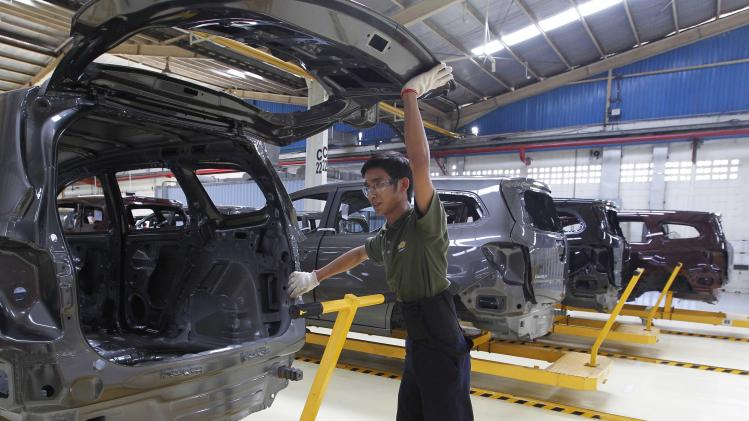 File photo of an employee working on a Chevrolet Spin MPV at a General Motors plant in Bekasi, outskirt of Jakarta