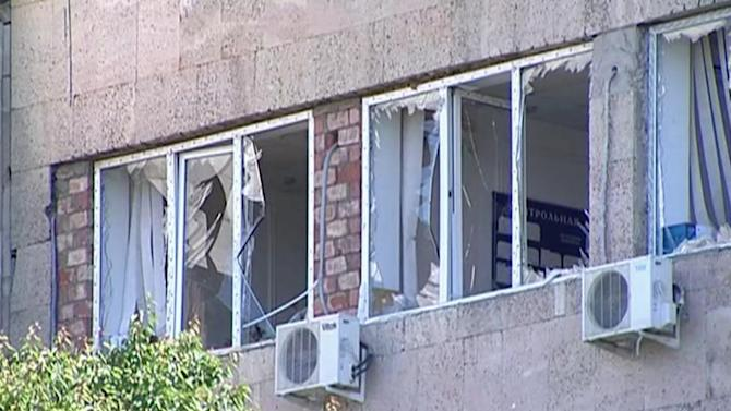 This image taken from AP video shows the scene of a blast with smashed windows in Makhachkala in the southern Russian region of Dagestan on Saturday, May 25, 2013. A female suicide bomber blew herself up in the southern Russian region of Dagestan on Saturday, injuring at least 18, including two children and five police officers, authorities said. The attacker was later identified as a widow of two Islamic radicals killed by security forces. It was the first suicide bombing in Dagestan since the Boston Marathon attacks last month. (AP Photo/AP video)