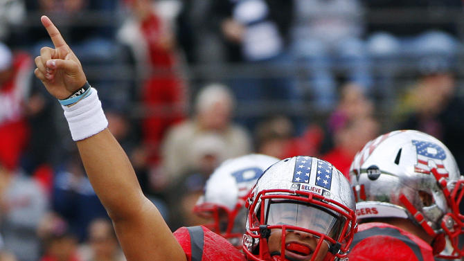 FILe p- This Nov. 10, 2012 file photo shows Rutgers quarterback Gary Nova (15) gesturing after a touchdown pass against Army in first half of an NCAA college football game in Piscataway, N.J. . Rutgers is announcing that it will join the Big Ten at an afternoon news conference Tuesday, Nov. 20, 2012, on its campus in Piscataway, N.J. (AP Photo/Rich Schultz, File)