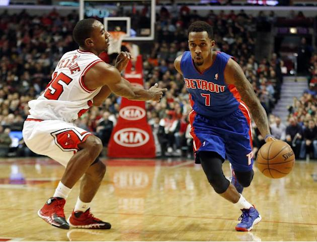 Detroit Pistons guard Brandon Jennings, right, drives to the basket against Chicago Bulls guard Marquis Teague, left, during the second half of an NBA basketball game in Chicago, Saturday, Dec. 7, 201