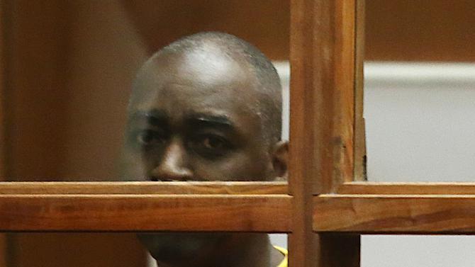 """Actor Michael Jace, center, appears in Los Angeles Superior Court for a preliminary hearing of the charge that he murdered his wife, Friday, Aug. 1, 2014. Jace waived his right to a preliminary hearing, which means the case will proceed to trial without an initial presentation of evidence to a judge. Jace played a police officer on """"The Shield"""" TV series, appeared in the show """"Southland"""" and had small roles in such movies as """"Boogie Nights"""" and """"Forrest Gump."""" (AP Photo/Frederick Brown, Pool)"""