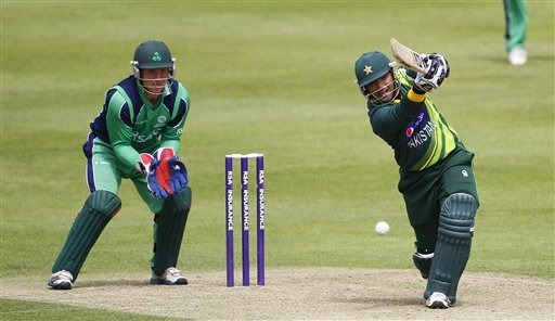 Pakistan's Asad Shafiq, right, batting as Ireland wicket keeper Gary Wilson looks on during their One Day Cricket  International at Clontarf Cricket Club, Dublin, Ireland, Thursday, May 23, 2013