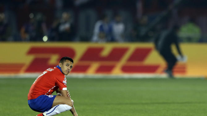Chile's Alexis Sanchez  waits for the beginning of a Copa America semifinal soccer match against Peru at the National Stadium in Santiago, Chile, Monday, June 29, 2015. (AP Photo/Ricardo Mazalan)