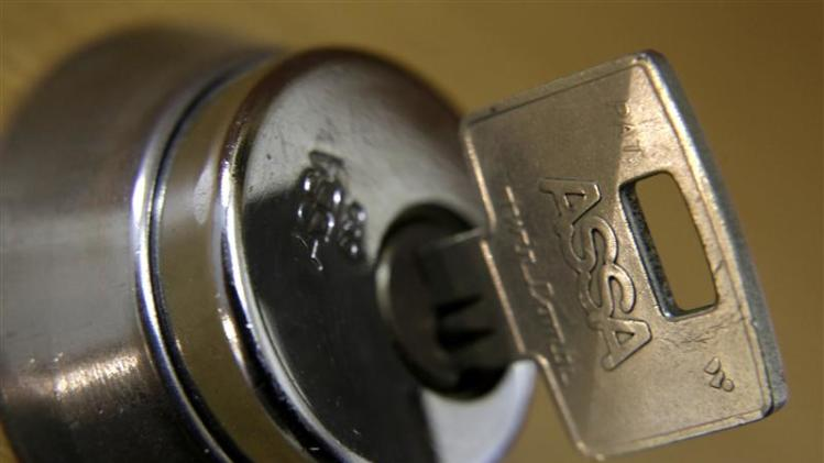 An Assa Abloy lock and key are displayed in a shop in Riga