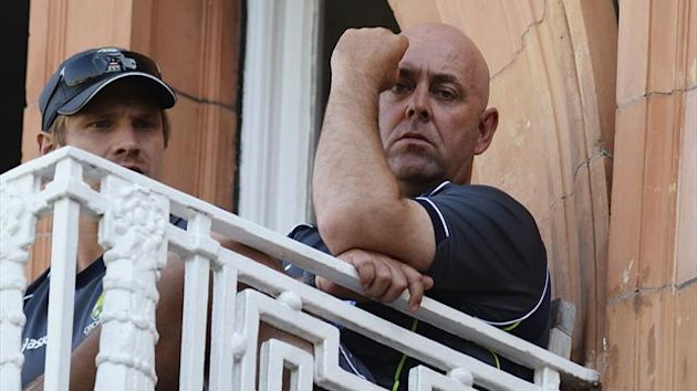 Australia's coach Darren Lehmann looks on from the dressing room balcony with player Shane Watson (L) during the second Ashes test cricket match against England at Lord's cricket ground in London July 21, 2013 (Reuters)