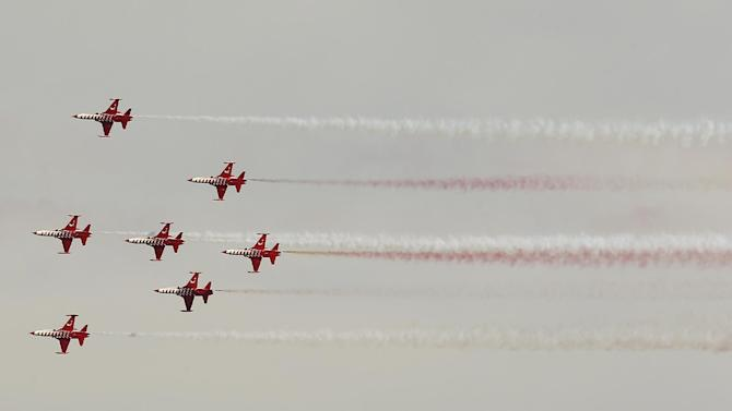 Aircrafts of the Turkish army aerobatic demonstration team, known as the Turkish prior to a ceremony at the Helles Memorial in the Gallipoli peninsula, Friday, April 24, 2015. The Helles Memorial, built in 1924 and bearing more than 21,000 names serves the dual function of Commonwealth battle memorial for the whole Gallipoli campaign and place of commemoration for many of those British and Commonwealth servicemen who died there and have no known grave. As world leaders gather with the descendants of the fighters in Gallipoli, the memories of one of the most harrowing campaigns of the 20th century have come surging back to life. The doomed Allied offensive to secure a naval route from the Mediterranean to Istanbul through the Dardanelles, and take the Ottomans out of the war, resulted in over 130,000 deaths on both sides. (AP Photo/Emrah Gurel)