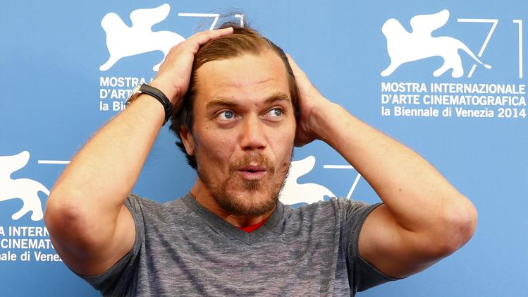 """Actor Michael Shannon poses during the photo call for the movie """"99 Homes"""" at the 71st Venice Film Festival"""