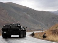 Turkish soldiers block a road near the town of Yuksekova, in the province of Van, eastern Turkey in 2007. Fighting between soldiers and Kurdish rebels in southeast Turkey killed 28 people, threatening to torpedo a rare opening for negotiations to resolve a decades-old separatist conflict