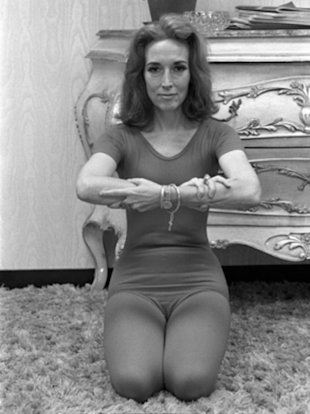 Cosmopolitan editor Helen Gurley Brown doing exercise in her office in the 1970s