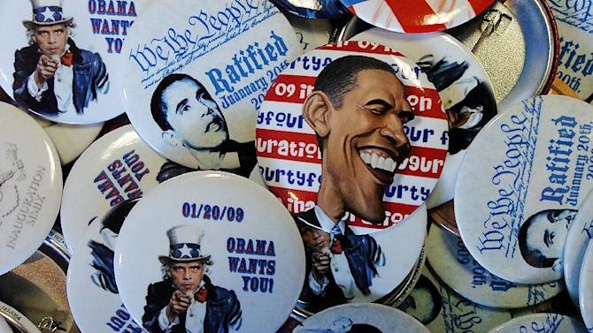 President Barack Obama buttons at the Obama field office located on Wyoming Avenue  in Scranton, Pa., on Tuesday, Nov. 6, 2012 during Election Day.  (AP Photo/Scranton Times & Tribune, Butch Comegys)  WILKES BARRE TIMES-LEADER OUT; MANDATORY CREDIT