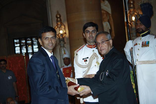 Indian President Pranab Mukherjee presents the Padma Bhushan award to former Indian Cricket captain Rahul Dravid during the presentation of the 'Padma Awards 2013' at The Presidential Palace in New De