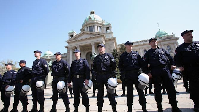 Serbian riot police guard Serbia's parliament building in Belgrade, Serbia, Friday, April 26, 2013. Serbian lawmakers are debating an EU-brokered deal on normalization of ties with breakaway Kosovo which was signed by the government and sets the former war foes on the path of reconciliation and EU integration. (AP Photo/Darko Vojinovic)