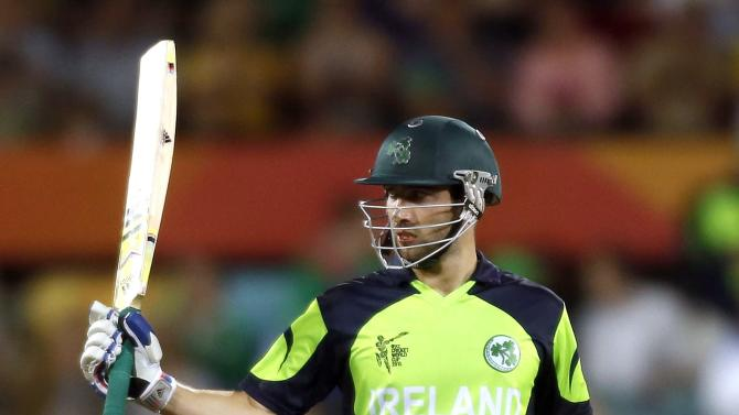 Ireland's Andrew Balbirnie celebrates reaching his fifty runs during the Cricket World Cup match against South Africa at Manuka Oval in Canberra