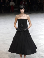 A model wears a creation by Japanese fashion designer Yohji Yamamoto for his Fall/Winter 2013-2014 ready to wear collection, in Paris, Friday, March 1, 2013. (AP Photo/Christophe Ena)