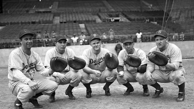 FILE - In this Feb. 21, 1947 file photo, players from the Brooklyn Dodgers' catching squad, from left, Dixie Howell, Gil Hodges, Ferrell Anderson, Bob Bragan and Bruce Edwards, line up for a portrait at the National League Pennant Race in Havana, Cuba. Despite deep political and ideological differences over the years, Cuba and the United States have always shared a love of baseball. The Wednesday, Dec. 17, 2014 announcement that the U.S. plans to restore diplomatic ties with the Caribbean nation could usher in a new era in U.S.-Cuba baseball relations, which were strained after the Castro revolution and the U.S.-led economic embargo. (AP Photo, File)