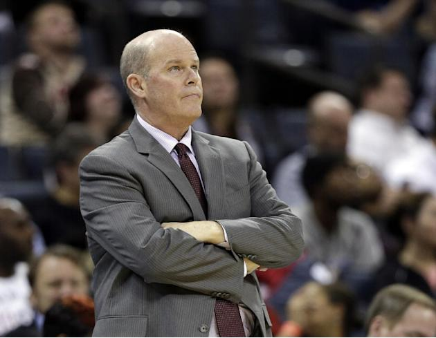 Charlotte Bobcats head coach Steve Clifford looks up at the scoreboard during the second half of an NBA basketball game against the Orlando Magic in Charlotte, N.C., Wednesday, Dec. 11, 2013. The Magi