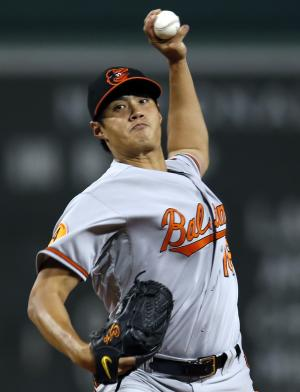 Baltimore Orioles starting pitcher Wei-Yin Chen (16) delivers to the Boston Red Sox in the first inning of a MLB American League baseball game at Fenway Park in Boston, Wednesday, Sept. 18, 2013. (AP Photo/Elise Amendola)