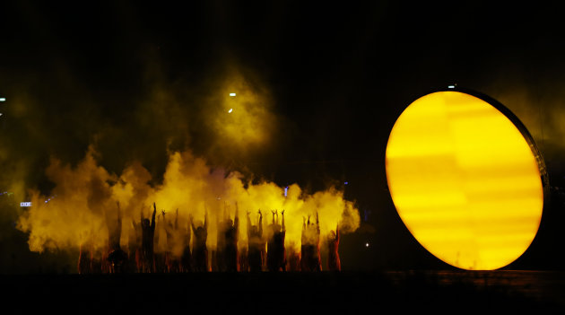 Performers dance during the Opening Ceremony at the 2012 Summer Olympics, Friday, July 27, 2012, in London. (AP Photo/Matt Dunham)
