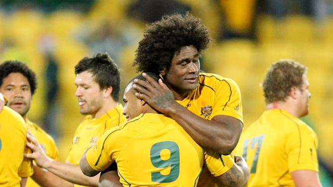 Australia's Radike Samo congratulates teammate Will Genia after their Rugby World Cup quarterfinal win over South Africa in Wellington, New Zealand, Sunday, Oct. 9, 2011. (AP Photo/Junji Kurokawa)