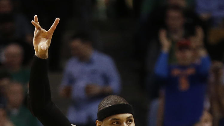 New York Knicks' Carmelo Anthony heads back upcourt after hitting a basket during the second quarter of their 90-76 win over the Boston Celtics in Game 3 of a first-round NBA basketball playoff series in Boston, Friday, April 26, 2013. (AP Photo/Winslow Townson)