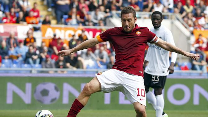 AS Roma's Totti try to control the ball during their Serie A soccer match against Atalanta at the Olympic stadium in Rome