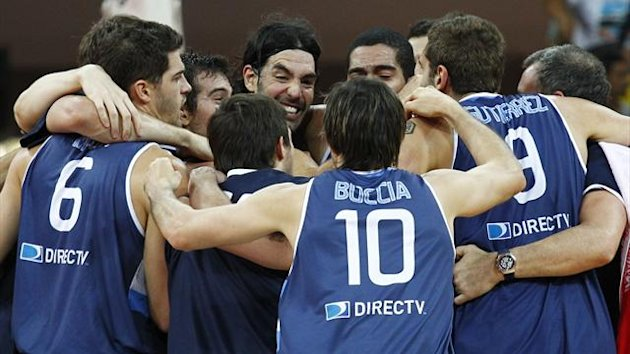 Argentine players celebrate after defeating Canada at the FIBA Americas Championship basketball game in Caracas September 8, 2013. Argentina will progress to the World Cup in Spain next year. REUTERS