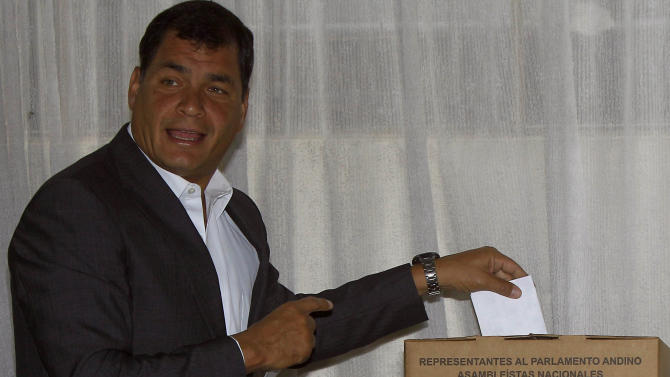 President Rafael Correa casts his vote for the National Assembly members in Quito, Ecuador, Sunday, Feb. 17, 2013.  Ecuadoreans  elect president,  vice-president and National Assembly members Sunday  with Correa highly favored to win a second re-election. His  government has won broad backing from the lower classes as it leads Latin America in social spending.(AP Photo/Dolores Ochoa)