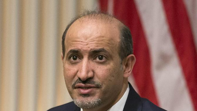 """President Ahmad al-Jarba, president of the National Coalition for Syrian Revolutionary and Opposition Forces, speaks at the U.S. Institute of Peace, on Wednesday, May 7, 2014, in Washington. Al-Jarba said that rebel forces need weapons that could """"neutralize'' aerial raids by President Bashar Assad's air force in order to change the balance of power on the ground and pave the way for a political solution to the crisis. (AP Photo/ Evan Vucci)"""