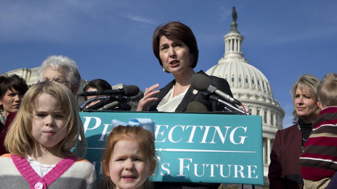Rep. Cathy McMorris Rodgers, R-Wash., center, accompanied by  Rep. Renee Ellmers, R-N.C., right, and others, gestures as she speaks during a news conference on Capitol Hill in Washington, Wednesday, Dec. 12, 2012, to talk about the effect of the national debt on American families.  (AP Photo/Manuel Balce Ceneta)