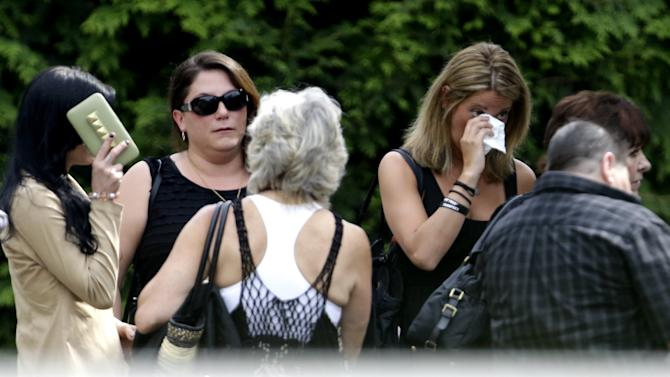 """People arrive at Robert Spearing Funeral Home for a private viewing for actor James Gandolfini, Wednesday, June 26, 2013, in Park Ridge, N.J. Gandolfini, who played Tony Soprano in the HBO show """"The Sopranos"""", died while vacationing in Italy last week. (AP Photo/Julio Cortez)"""
